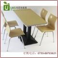 快餐厅桌椅一桌四椅组合 梯形铸铁台脚 钢木结构餐桌椅定做 质保两年